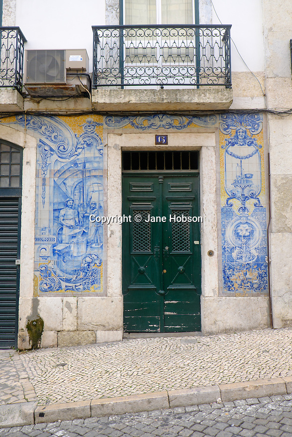 Lisbon, Portugal. 21.03.2015. Typical hand-painted tiles on the outside wall of a house in the Alfama district of Lisbon. © Jane Hobson.