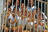 Trinidad Cuba School Children in uniforms  saying Hello, Republic of Cuba,