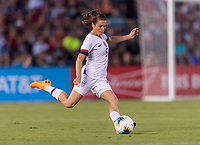 PASADENA, CA - AUGUST 4: Kelley O'Hara #5 crosses the ball during a game between Ireland and USWNT at Rose Bowl on August 3, 2019 in Pasadena, California.