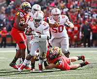 Ohio State Buckeyes quarterback J.T. Barrett (16) escapes Maryland Terrapins linebacker Cole Farrand (47) on his way to scoring a touchdown during the fourth quarter of the NCAA football game at Byrd Stadium in College Park, Maryland on Oct. 4, 2014. (Adam Cairns / The Columbus Dispatch)