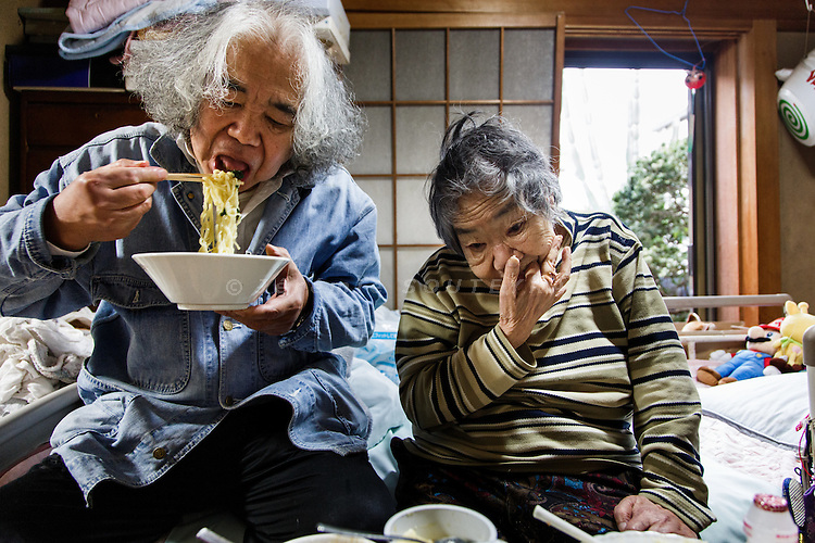 Kawasaki, November 6 2014 - Japanese artist Tatsumi ORIMOTO, 69, at home taking care of his 97-year-old mother.