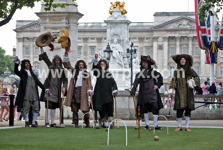 """**ALL ROUND PICTURES FROM SOLARPIX.COM**.**NO UK NEWSPAPER PUBLICATION**.**UK MAGAZINE & SUPPLEMENT PUBLICATION ONLY** AND NO PUBLICATION IN AUSTRALIA, FRANCE, GERMANY, ITALY AND SCANDINAVIA** .Anyone for croquet?..Pall Mall, close to Buckingham Palace, was transformed into a 17th century croquet lawn today. The event kicked off a campaign to engage Londoners and tourists in the history behind the naming of the capital's streets. Pall Mall was named after  matches of croquet  """"paille maille"""" played in the area during the reign of Charles II. Pall Mall, London, UK. 16 June 2009..This pic: Croquet..JOB REF: 9256 SFE       DATE: 16_06_2009.**MUST CREDIT SOLARPIX.COM OR DOUBLE FEE WILL BE CHARGED**.**ONLINE USAGE FEE GBP 50.00 PER PICTURE - NOTIFICATION OF USAGE TO PHOTO @ SOLARPIX.COM**.**CALL SOLARPIX : +34 952 811 768 or LOW RATE FROM UK 0844 617 7637**"""