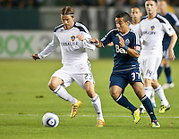 CARSON, CA - September 17, 2011: LA Galaxy midfielder David Beckham (23) and Vancouver Whitecaps midfielder Camilo (37) during the match between LA Galaxy and Vancouver Whitecaps at the Home Depot Center in Carson, California. Final score LA Galaxy 3, Vancouver Whitecaps 0.