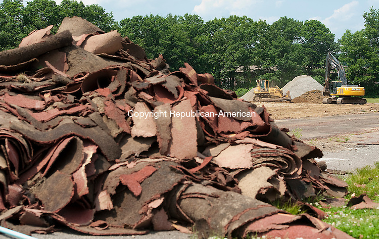 TORRINGTON, CT-061714JS03--Work has begun at Torrington High School as the old track and field is torn up to make way for a new $2.9 million upgrade to the facility. <br /> Park Jim Shannon Republican-American