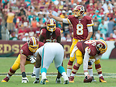 Washington Redskins quarterback Kirk Cousins (8) calls signals during the second quarter of the game against the Miami Dolphins at FedEx Field in Landover, Maryland on September 13, 2015.  Also recognizable are: offensive tackle Brandon Scherff (75), running back Matt Jones (31), and center Kory Lichtensteiger (78)<br /> Credit: Ron Sachs / CNP