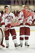 Pier-Olivier Michaud (Harvard - 39), Michael Biega (Harvard - 27) - The Harvard University Crimson defeated the St. Lawrence University Saints 4-3 on senior night Saturday, February 26, 2011, at Bright Hockey Center in Cambridge, Massachusetts.
