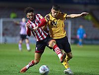 Lincoln City's Kellan Gordon vies for possession with  Wolverhampton Wanderers U21's Ryan Giles<br /> <br /> Photographer Andrew Vaughan/CameraSport<br /> <br /> The EFL Checkatrade Trophy Northern Group H - Lincoln City v Wolverhampton Wanderers U21 - Tuesday 6th November 2018 - Sincil Bank - Lincoln<br />  <br /> World Copyright © 2018 CameraSport. All rights reserved. 43 Linden Ave. Countesthorpe. Leicester. England. LE8 5PG - Tel: +44 (0) 116 277 4147 - admin@camerasport.com - www.camerasport.com