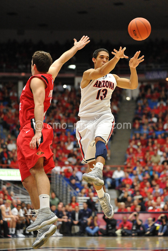 Nov 23, 2011; Tucson, AZ, USA; Arizona Wildcats guard Nick Johnson (13) passes the ball in the first half of a game against the San Diego State Aztecs at the McKale Center.  Mandatory Credit: Chris Morrison-US PRESSWIRE