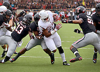 STAFF PHOTO BEN GOFF  @NWABenGoff -- 09/13/14 Arkansas running back Jonathan Williams (32) evades Texas Tech defenders as he runs into the end zone for his first touchdown in the first quarter of the game in Jones AT&T Stadium in Lubbock, Texas on Saturday September 13, 2014.