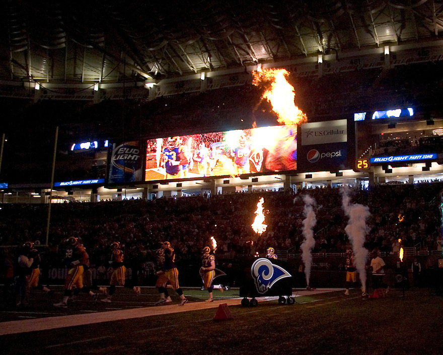 October 11, 2009 - St Louis, Missouri, USA - The St Louis Rams take the field flanked by flames before the game between the St Louis Rams and the Minnesota Vikings at the Edward Jones Dome.  The Vikings defeated the Rams 38 to 10.  .
