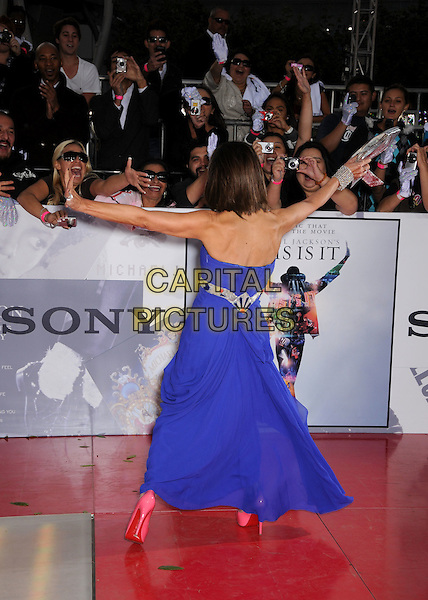 PAULA ABDUL .'This Is It' Los Angeles Premiere held at NOKIA Theatre L.A. LIVE, Los Angeles, California, USA, .27th October 2009..full length strapless blue dress back rear behind arms outstretched fans waving patent pink shoes .CAP/ADM/BP.©Byron Purvis/Admedia/Capital Pictures