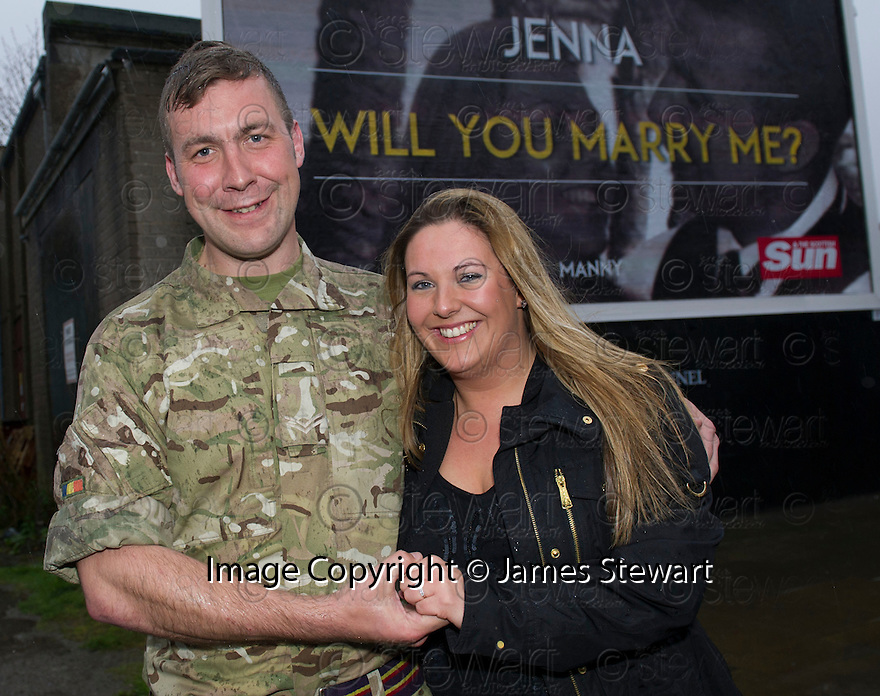 "Jenna Stewart  after accepting the wedding proposal from her boyfriend Paul ""Manny"" Davies after he displayed it on a giant billboard poster in High Street, Kirkcaldy."