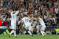 Real Madrid's Spanish midfielder Marco Asensio celebrating after scoring