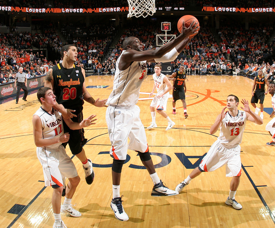 Jan. 27, 2011; Charlottesville, VA, USA; Virginia Cavaliers center Assane Sene (5) grabs the rebound in front of Maryland Terrapins forward Jordan Williams (20, Virginia Cavaliers guard Joe Harris (12) and Virginia Cavaliers guard Sammy Zeglinski (13) during the game at the John Paul Jones Arena. Maryland won 66-42. Mandatory Credit: Andrew Shurtleff