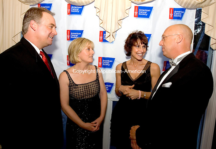 SOUTHINGTON, CT--21 APRIL 2007--042107JS01-Gala Master of Ceremonies Bob Maxom, meterologist on NBC 30, left, talks with American Cancer Society's Angel of Hope Award recipients Nancy M. Cappello, Ph.D., Dr. Ellen G. Polokoff and Joseph J. Vrabley, Jr., during the American Cancer Society's 2007 Hope Gala Saturday at the Aqua Turf in Southington.  <br /> Jim Shannon / Republican-American