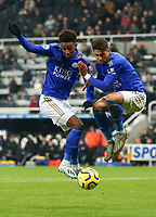 1st January 2020; St James Park, Newcastle, Tyne and Wear, England; English Premier League Football, Newcastle United versus Leicester City; Demarai Gray of Leicester City miscues his shot as Ayoze Perez of Leicester City goes for the same ball - Strictly Editorial Use Only. No use with unauthorized audio, video, data, fixture lists, club/league logos or 'live' services. Online in-match use limited to 120 images, no video emulation. No use in betting, games or single club/league/player publications