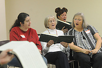 NWA Democrat-Gazette/FLIP PUTTHOFF <br /> Sacred Harp singers Brandy Siler (from left) Katy Black, Bonnie Wood and Bonnie Whitbeck sing Saturday, Oct. 24 2015 at the Sacred Harp Singing Convention in Spingdale.