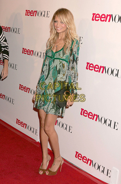 NICOLE RICHIE.Teen Vogue Young Hollywood Issue held at The Sunset Tower Hotel, West Hollywood, California, USA,.20th September 2006..full length green patterned print dress clutch bag  skinny thin brown open toe slingbacks shoes tattoo on ankle.Ref: ADM/RE.www.capitalpictures.com.sales@capitalpictures.com.©Russ Elliot/AdMedia/Capital Pictures.