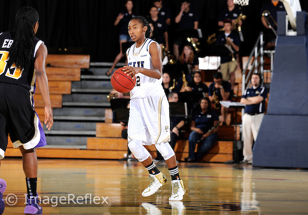 Florida International University guard Jerica Coley (22) plays against East Carolina University. FIU won the game 76-75 in overtime on January 11, 2014 at Miami, Florida.