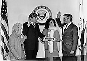 United States Senator John W. Warner (Republican of Virginia), left center, is sworn-in by U.S. Vice President Walter Mondale, right.  Looking on is Warner's wife, Actress Elizabeth Taylor, right, center, and Senator Warner's mother, Mrs. Martha Warner, right, look on in Washington, D.C. on January 15, 1979.  The ceremony followed Senator Warner's official swearing-in in the U.S. Senate Chamber.Credit: U.S. Senator Warner's Office via CNP