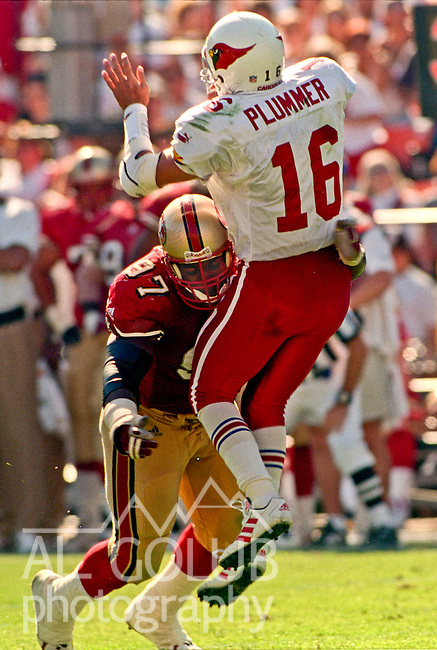 San Francisco 49ers vs. Arizona Cardinals at Candlestick Park Sunday, October 1, 2000.  49ers beat Cardinals 27-20.  San Francisco 49ers defensive tackle Bryant Young (97) hits Arizona Cardinals quarterback Jake Plummer (16).