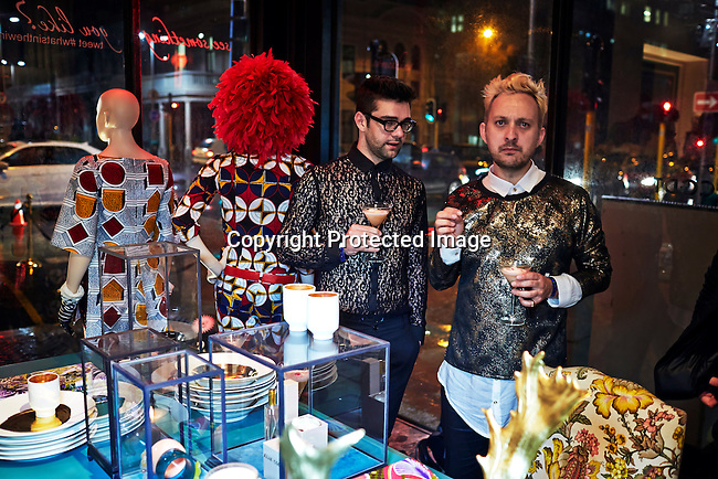 CAPE TOWN, SOUTH AFRICA - JULY 26: Guests party during an installation show at the new Klûk CGDT flagship store during Mercedes-Benz Fashion Week on July 26, 2014, in Cape Town, South Africa. Klûk CGDT, created by the designers Malcolm KLûK and Christiaan Gabriel Du Toit. The elite of Cape Town came out for the launch of the store and the late night party. (Photo by Per-Anders Pettersson)