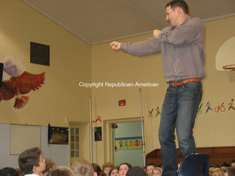 "WOODBURY, CT - 26 January 2010 - 102610RH03 - Jake Halpern, co-author of the fantasy book, ""Dormia,"" acts out a scene while talking to pupils at Mitchell Elementary School in Woodbury Tuesday"