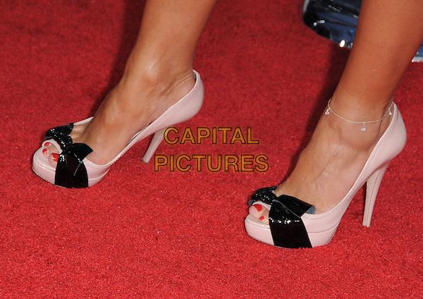 "KARINA SMIRNOFF's shoes  .at the CBS Films' L.A. Premiere of ""The Back-Up Plan"" held at The Village Theatre in Westwood, California, USA, April 21st, 2010..arrivals detail pink platform black bows feet patent .CAP/RKE/DVS.©DVS/RockinExposures/Capital Pictures."