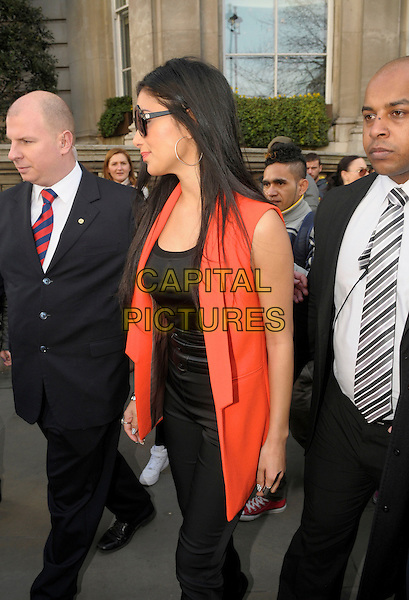 Nicole Scherzinger leaving her hotel in central London, England..4th March 2013.full length black orange sleeveless blazer top sunglasses shades trousers minders security bodyguards side profile .CAP/IA.©Ian Allis/Capital Pictures.