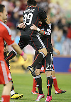 Jaime Moreno #99 of D.C. United leaps into the arms of Santino Quaranta #25 after scoring during an MLS match against Toronto FC that was the final appearance of D.C. United's Jaime Moreno at RFK Stadium, in Washington D.C. on October 23, 2010. Toronto won 3-2.