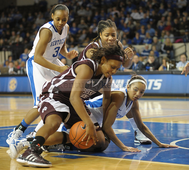 Kentucky's Keyla Snowden (4) goes to the floor for a loose ball during the second half of the University of Kentucky Women's basketball game against Mississippi State at Memorial Coliseum in Lexington, Ky., on 1/8/12. Uk won the game 88-40. Photo by Mike Weaver | Staff