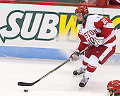 The visiting Harvard University Crimson defeated the Boston University Terriers 3-2 in overtime on Tuesday, November 25, 2014, at Agganis Arena in Boston, Massachusetts.