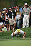 7 September 2008:    As spectators look on, Camilo Villegas does his signature balancing act to check his putt in the fourth and final round of play at the BMW Golf Championship at Bellerive Country Club in Town & Country, Missouri, a suburb of St. Louis, Missouri on Sunday September 7, 2008. The BMW Championship is the third event of the PGA's  Fed Ex Cup Tour.