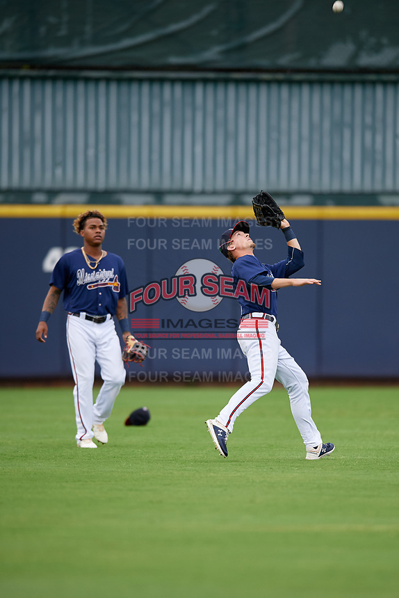 Mississippi Braves left fielder Drew Waters (3) catches a fly ball as center fielder Cristian Pache (16) looks on during a Southern League game against the Jacksonville Jumbo Shrimp on May 4, 2019 at Trustmark Park in Pearl, Mississippi.  Mississippi defeated Jacksonville 2-0.  (Mike Janes/Four Seam Images)