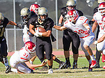 Palos Verdes, CA 10/21/16 - Jeffrey Jimena (Peninsula #6), Aaron Hatfield (Redondo Union #10), \r31\ and Zackary Denney (Peninsula #60) in action during the CIF Southern Section Bay League Redondo Union - Palos Verdes Peninsula game at Peninsula High School.