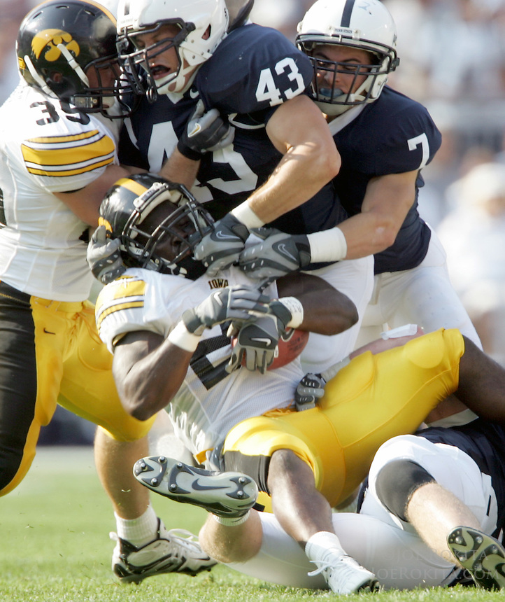 State College, PA -- 10/6/2007 -- Penn State linebacker Josh Hull (43) and defensive back Anthony Scirrotto (7) tackle Iowa running back Albert Young during the game against Iowa.  Penn State defeated Iowa by a score of 27-7 on Saturday, October 6, 2007, at Beaver Stadium.    ..Photo:  Joe Rokita / JoeRokita.com