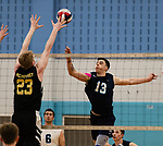 OXFORD,  CT-041519JS15- Oxford's Oxford's Patrick Mucherino (13) tips the ball just over the outstretched arms of Joel Barlow's Finn McCaffrey (23) during their match Monday at Oxford High School. <br /> Jim Shannon Republican American