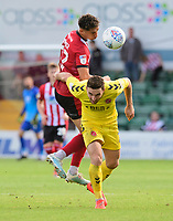 Lincoln City's Tyler Walker vies for possession with Fleetwood Town's Lewis Coyle<br /> <br /> Photographer Chris Vaughan/CameraSport<br /> <br /> The EFL Sky Bet League One - Lincoln City v Fleetwood Town - Saturday 31st August 2019 - Sincil Bank - Lincoln<br /> <br /> World Copyright © 2019 CameraSport. All rights reserved. 43 Linden Ave. Countesthorpe. Leicester. England. LE8 5PG - Tel: +44 (0) 116 277 4147 - admin@camerasport.com - www.camerasport.com