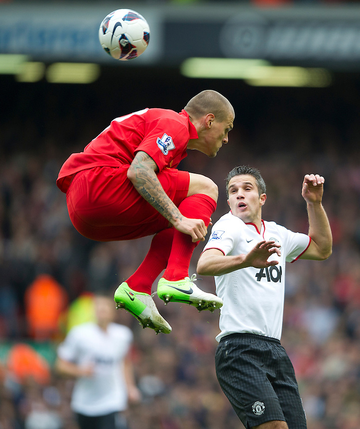 Liverpool's Martin Skrtel and Manchester United's Robin van Persie ..Football - Barclays Premiership - Liverpool v Manchester United - Sunday 23rd September 2012 - Anfield - Liverpool..