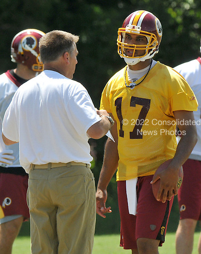 Ashburn, VA - June 11, 2008 -- Washington Redskins quarterback Jason Campbell (17) takes instruction from new head coach Jim Zorn during an organized team activity (OTA) as part of their preparations for the 2008 National Football League season at their training facility, Redskins Park in Ashburn, Virginia on Wednesday, June 11, 2008..Credit: Ron Sachs / CNP