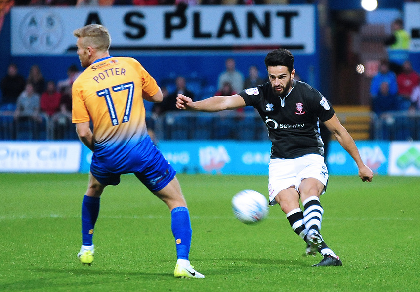 Lincoln City's Sam Habergham crosses under pressure from Mansfield Town's Alfie Potter<br /> <br /> Photographer Andrew Vaughan/CameraSport<br /> <br /> The EFL Checkatrade Trophy - Mansfield Town v Lincoln City - Tuesday 29th August 2017 - Field Mill - Mansfield<br />  <br /> World Copyright &copy; 2018 CameraSport. All rights reserved. 43 Linden Ave. Countesthorpe. Leicester. England. LE8 5PG - Tel: +44 (0) 116 277 4147 - admin@camerasport.com - www.camerasport.com