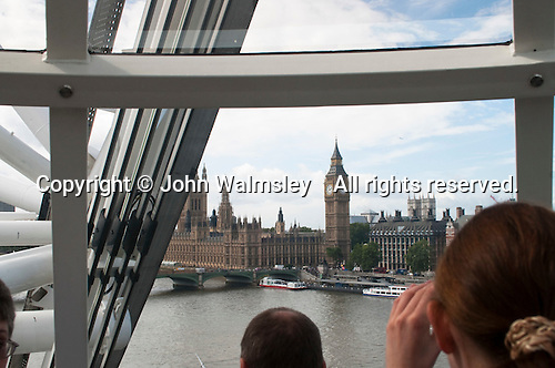 View of Big Ben and the Houses of Parliament from the London Eye on the Southbank of the River Thames in London.  Stands 135 metres tall and carries 3.5 million visitors each year.  Conceived and designed by David Marks & Julia Barfield, it took 7 years to design & build and involved products made by specialists in 5 countries.   It was originally sponsored by British Airways, who ran it from 2000 until 2005, when it was known as the Millenium Wheel.