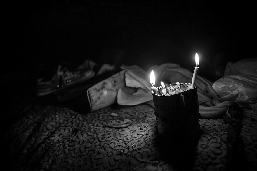 Candles illuminates the underground home of several street children and young adults. Thousands of minors and young adults live in Bucharest's vast system of underground canals used for heating, water and sewage pipes. Many were raised in Romania's vast orphanage system. Addiction, especially to huffing metallic paint, heroine and other injected drugs is widespread.
