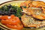 Heart healthy meal of grilled salmon, spinach, fruit