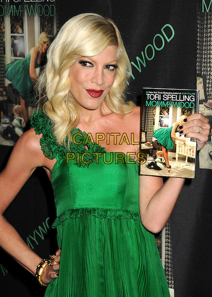 """TORI SPELLING.Tori Spelling Celebrates the Release of her new book """"Mommywood"""" held at The Thompson Hotel, Beverly Hills, California, USA..April 13th, 2009.half length green one shoulder dress ruffled ruffles frills pleats pleated red lipstick hand on hip.CAP/ADM/BP.©Byron Purvis/AdMedia/Capital Pictures."""