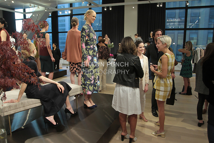 Guests attend the Ann Taylor Fall Winter 2016 collection fashion presentation, at 7 Times Square on April 20, 2016.