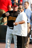July 22, 2009:  Stan Cliburn of the Rochester Red Wings with former Major League pitcher Luis Tiant at Frontier Field in Rochester, NY to throw out the ceremonial first pitch.  Tiant, from Cuba, played for the Cleveland Indians, Minnesota Twins, Boston Red Sox, New York Yankees, and California Angels.  Photo By Mike Janes/Four Seam Images