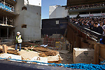 A workman in the site between the partly-demolished East Stand and the North Stand watching on as Tottenham Hotspur took on Watford in an English Premier League match at White Hart Lane. Spurs were due to make an announcement in April 2016 regarding when they would move out of their historic home and relocate to Wembley as their new stadium was completed. Spurs won this match 4-0 watched by a crowd of 31,706, a reduced attendance figure due to the ongoing ground redevelopment.