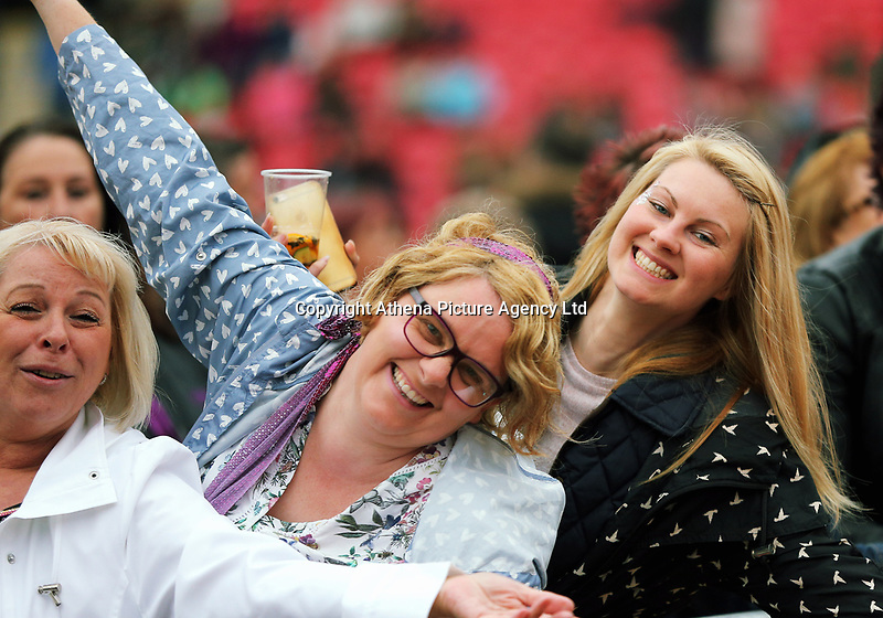 Fans dancing in the crowd<br />UB40 concert at Parc Y Scarlets, Llanelli, Wales, UK. Saturday 10 June 2017