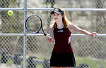 NAUGATUCK CT. 17 April 2019-041719SV09-Hannah Dumbrowski of Sacred Heart hits a ball to Cristina Reso of Naugatuck during tennis action in Naugatuck Wednesday.<br /> Steven Valenti Republican-American